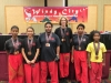 students posing with their medals
